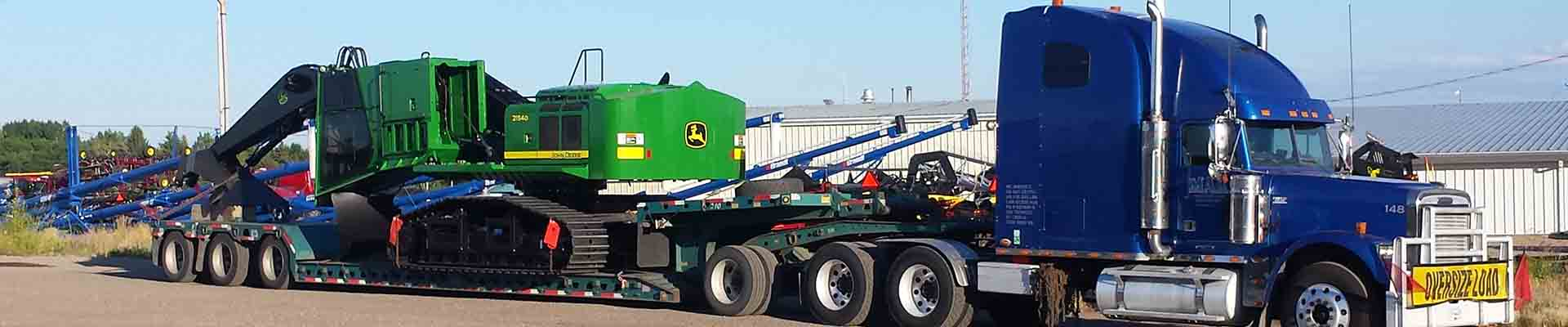 deere heavy equipment trucking canada